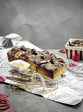 Hazelnut cake with syrup and prunes