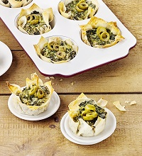 Phyllo tartlets with kale and olives