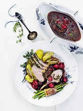 rack of lamb with herbal - cherrie sauce and beans and wedges