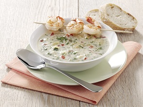 Onion cream soup with shrimp skewers