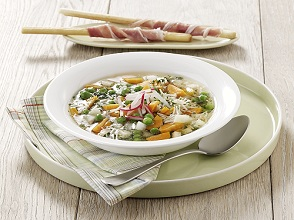 Spring vegetable soup with ham sticks
