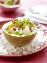 Melon stuffed with fruit salad *** Local Caption *** 88154417