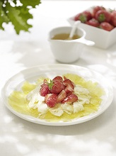 Pineapple Carpaccio with strawberries, cream cheese and honey *** Local Caption *** 88155324