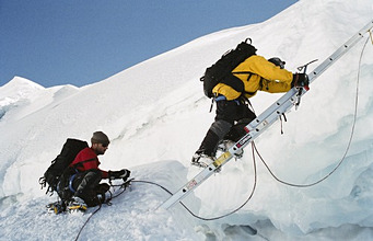 Crossing crevasse when climbing Huayna Potosi, Cordillera Real, Bolivia, South America