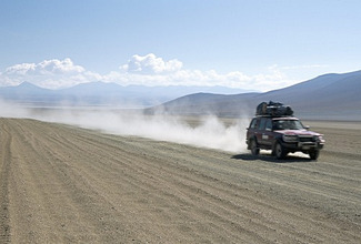 Land cruiser on altiplano track with tourists going to Laguna Colorado, Southwest Highlands, Bolivia, South America
