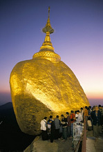 Balanced rock covered in gold leaf, major Buddhist stupa and pilgrim site, Kyaiktiyo, Myanmar (Burma), Asia