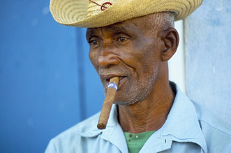 Portrait of a man with a Cuban cigar, Trinidad, Sancti Spiritus province, Cuba, West Indies, Central America