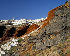 Volcanic rocks and Oia village, Oia, Santorini (Thira), Cyclades Islands, Greek Islands, Greece, Europe