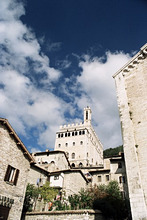 Buildings in the town with Palazzo dei Consoli in the background, Gubbio, Umbria, Italy, Europe