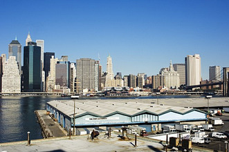 Port Authority buildings on the Brooklyn side of the East River with the Manhattan skyline beyond, New York City, New York, United States of America, North America