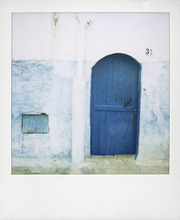 Polaroid of traditional painted blue door against whitewashed wall, Chefchaouen, Morocco, North Africa, Africa