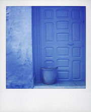 Polaroid of blue plastic bucket against blue door and blue wall, Chefchaouen, Morocco, North Africa, Africa