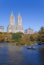 Central Park and the Grand buildings along Central Park West viewed across the lake in autumn, Manhattan, New York City, New York, United States of America, North America