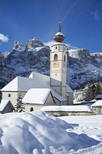 A church in Colfosco in Badia near the Sella Massif mountain range in the Dolomites, South Tyrol, Italy, Europe
