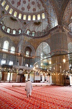 Blue Mosque interior, UNESCO World Heritage Site, mullah in foreground, Istanbul, Turkey, Europe