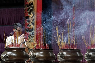 Incense sticks burning and smoking in joss stick pot in Taoist temple, Phuoc An Hoi Quan Pagoda, Ho Chi Minh City, Vietnam, Indochina, Southeast Asia, Asia