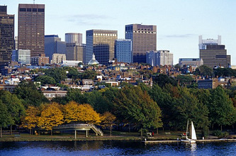 Sailing boat on Charles River in front of high rise buildings, Boston, Massachusetts, USA, America