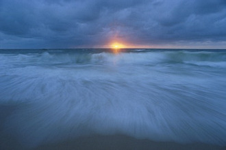 Sea view at sunset with breaking wave, Storm, North sea, Sylt, Germany