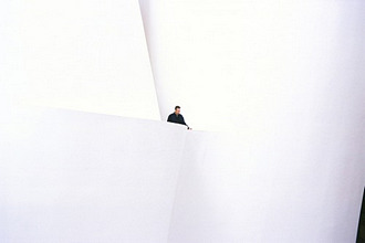 A man at the bright foyer of the Guggenheim Museum, Bilbao, Spain