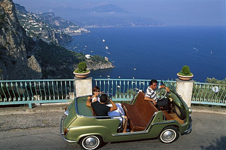 People in a vintage car at the coast in the sunlight, Amalficoast, Campania, Italy, Europe