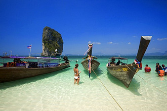 Boats anchored at beach, Tourists with lifejackets standing in water, Ko Poda in background, Laem Phra Nang, Railay, Krabi, Thailand