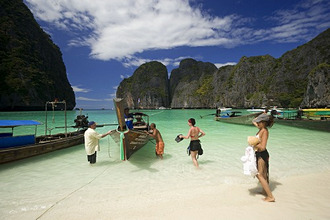 'Tourists next to anchored boats in the Maya Bay, a beautiful scenic lagoon, famous for the Hollywood film ''The Beach'', Ko Phi-Phi Leh, Ko Phi-Phi Islands, Krabi, Thailand, after the tsunami'