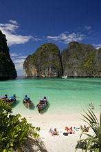 'View over Maya Bay, a beautiful scenic lagoon, famous for the Hollywood film ''The Beach'' with sunbathing tourists and anchored boats, Ko Phi-Phi Leh, Ko Phi-Phi Islands, Krabi, Thailand, after the tsunami'