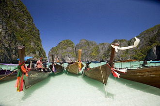 'Boats anchoring in the Maya Bay, a beautiful scenic lagoon, famous for the Hollywood film ''The Beach'', Ko Phi-Phi Leh, Ko Phi-Phi Islands, Krabi, Thailand, after the tsunami'