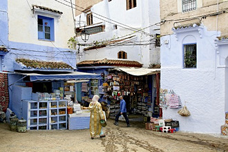 People walking through the alleys of Chefchaouen's medina, Chefchaouen, Morocco, Africa