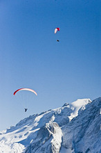 Paragliders above snow-covered Dolomites, Trentino-Alto Adige/Suedtirol, Italy