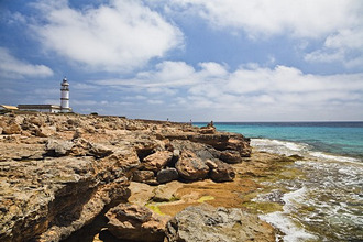 Lighthouse at the cape Cap de ses Salines under clouded sky, Mallorca, Balearic Islands, Mediterranean Sea, Spain, Europe