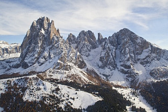 Snow covered mountains under clouded sky, Alpe di Siusi, Dolomites, Alto Adige, South Tyrol, Italy, Europe