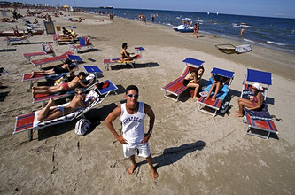 Lifeguard and people on sunloungers on the beach, Rimini, Adriatic Coast, Italy, Europe