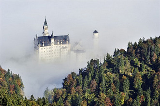 Neuschwanstein Castle above fog, Oberallgaeu, Bavaria, Germany