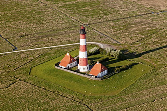 Aerial view of lighthouse at Westerheversand, Eiderstedt Peninsula, Northern Frisia, Schleswig-Holstein, Germany
