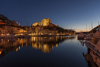 Europe, France, Corsica, Bonifacio, harbour and Old Town in the dusk