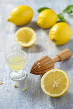 Lemons, citrus-press and juice
