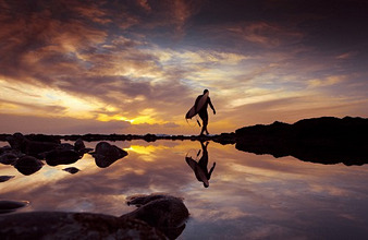 Surfer with evening mood by the sea, Playa de Las Americas, Tenerife, Canary Islands, Europe