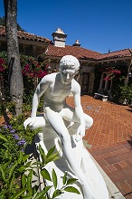 Greek statue before a guest villa at Hearst castle, Big Sur, California, USA
