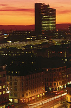 Norway, Oslo, view at the city, High-rise, lights, sunsetScandinavia, Norge, South Norway, capital, city, cityscape, buildings, construction, Biskop Gunnerus gate 14, Postgirobygget, PostHuset, mail Office building, BG14, dusk built 1975, evening, color mood orange