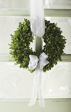 Christmassy door wreath of box with white bow