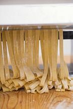 Making home-made ribbon pasta with pasta maker