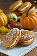 Two Pumpkin Whoopie Pies with Powdered Sugar, Gourds