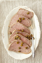 Sliced of roast beef with capers