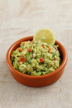 Classic Guacamole in a Glass Bowl, Fresh Avocados
