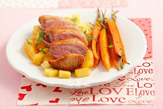 Duck breast with pineapple, oranges and baby carrots