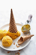 Mango sorbet with ice cream cones