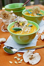 Cream of squash soup with apple crisps and pumpkin seeds