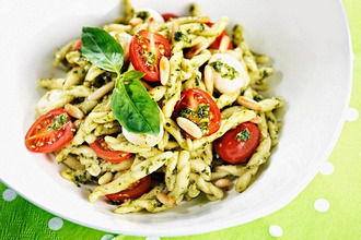 Strozzapreti pasta with pesto and cherry tomatoes