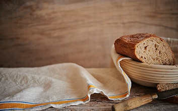 Fresh Artisan Bread on wooden surface with cloth